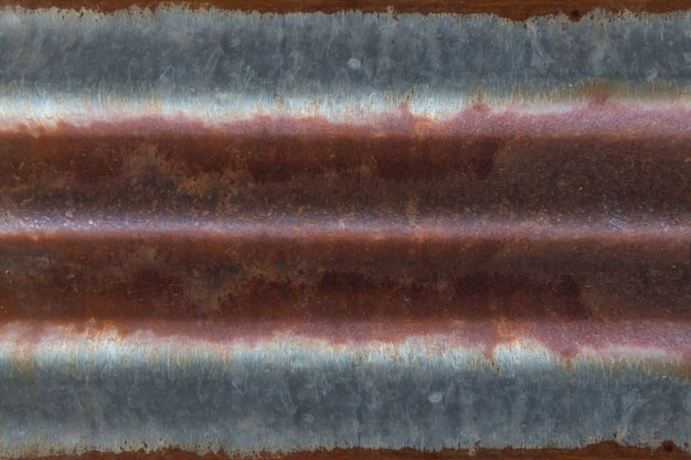 鋼板に古いさびたコートの抽象的なパターン