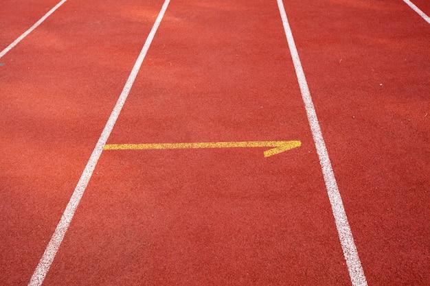 陸上競技用トラックオレンジ色の背景