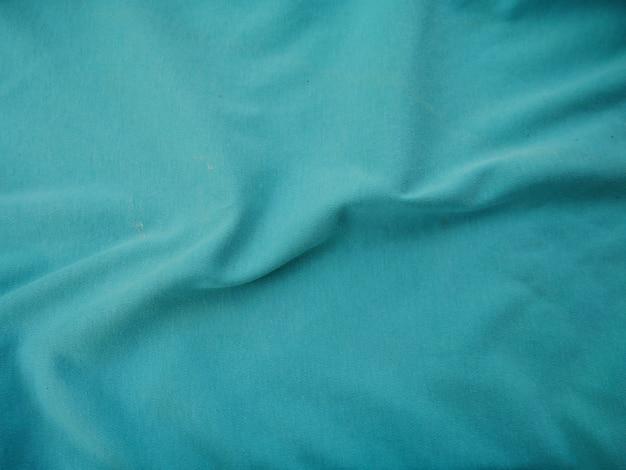 青い絹織物のテクスチャの背景