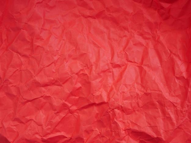 しわくちゃの赤い紙の背景