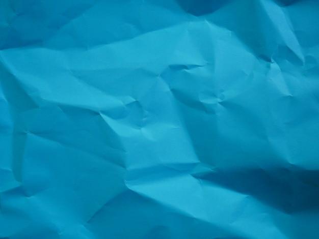 しわくちゃの青い紙の背景
