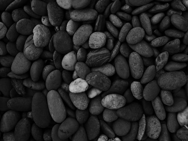 黒小石石のテクスチャ背景