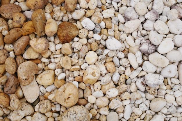 汚れた小石のビーチの石の背景