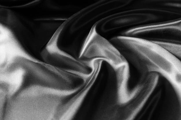 Черная шелковая ткань фон, текстура старой хлопковой ткани