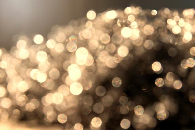 黄金の抽象的なボケ味光の背景