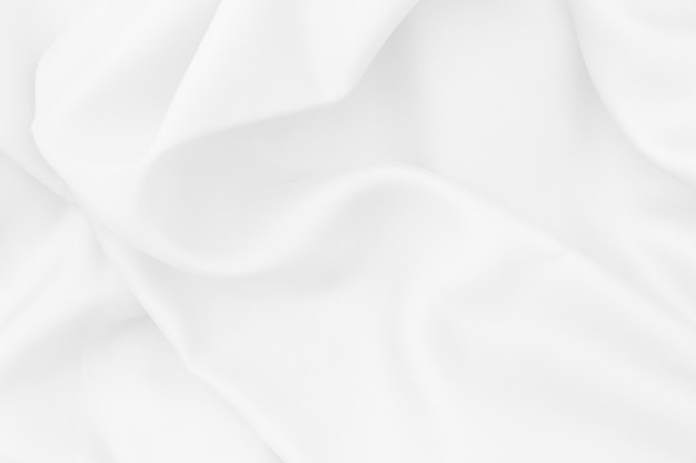 背景やデザイン、シルクやリネンの美しいパターンのための白い布の質感。