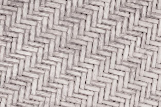 古い竹織りパターン、背景やデザインアート作品のための編まれた藤マットテクスチャ。