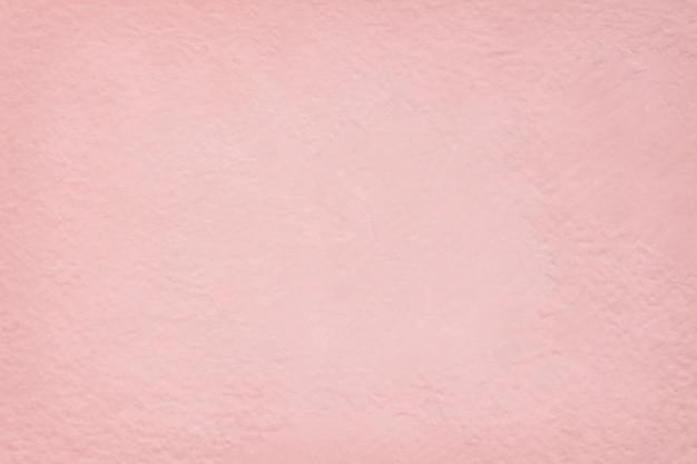 背景やデザインアート作品のためのピンクのセメント壁テクスチャ。
