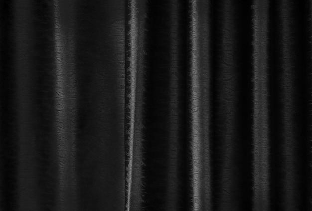 背景とデザインアート作品のための豪華な黒い絹のカーテンの質感。