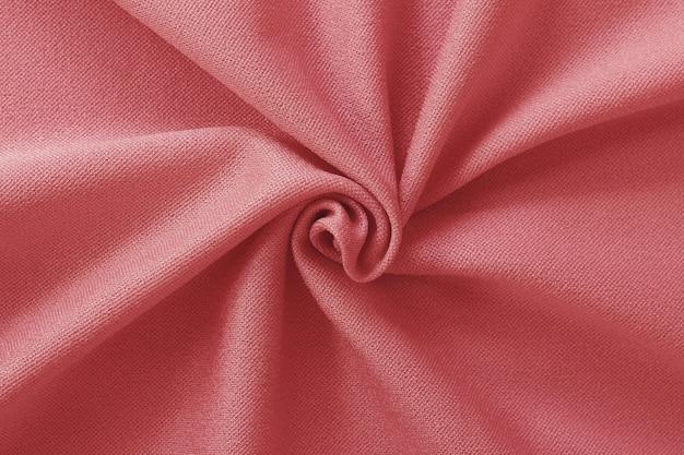背景とデザインアート作品のためのローズゴールドの布の質感