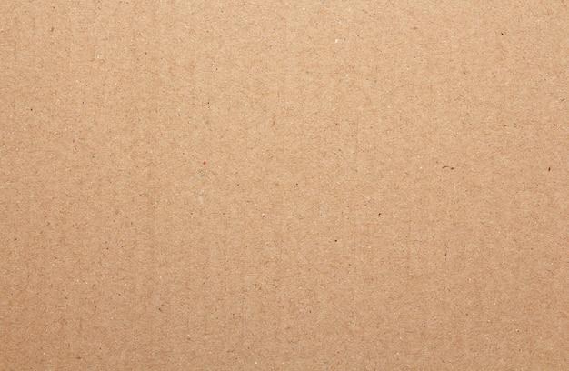 茶色のボール紙シートの抽象的な背景、古いヴィンテージのリサイクル紙箱の質感