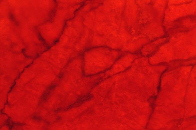 背景とデザインアート作品の高解像度の赤い大理石のテクスチャ。赤い石の床。