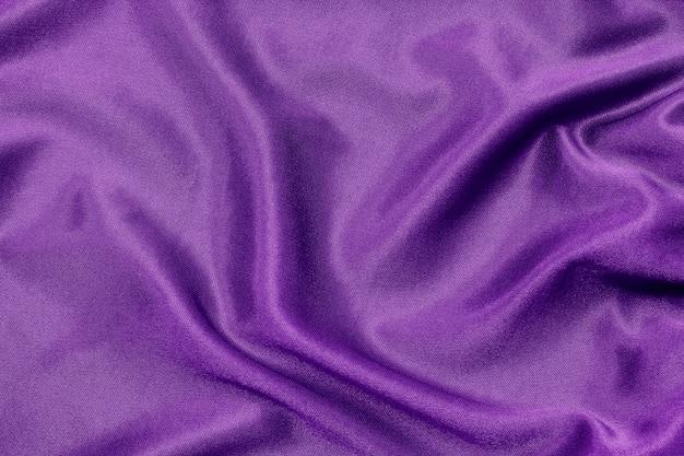 背景やデザイン、美しいシルクやリネンの紫色の布のテクスチャ。