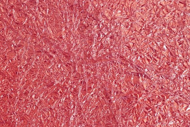 Текстура сусального розового золота сияющая, абстрактная красная упаковочная бумага для предпосылки и художественное произведение дизайна.