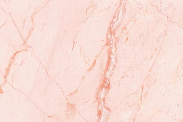 ローズゴールドの大理石のテクスチャ背景
