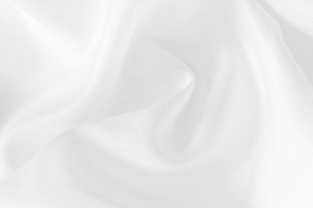 Текстура ткани белого цвета, красивый мятый узор из шелка или льна.