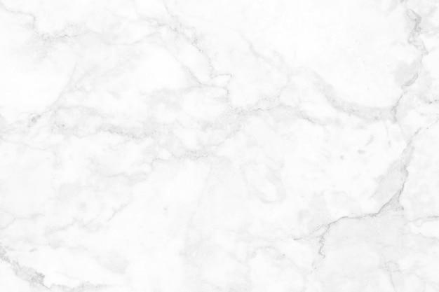 高解像度の自然なパターンの白灰色の大理石のテクスチャ背景、インテリアとエクステリアの豪華な石の床のシームレスなキラキラをタイルします。