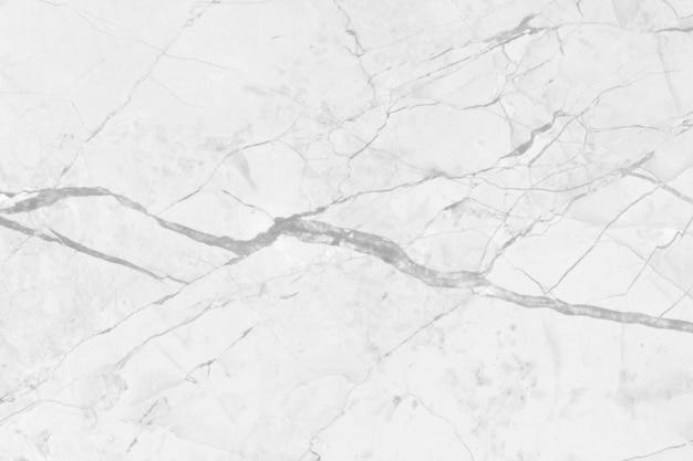 白灰色の大理石のテクスチャ背景、カウンターデザインとインテリアデザインのシームレスなキラキラパターンを持つ自然なタイル石の床のトップビュー。