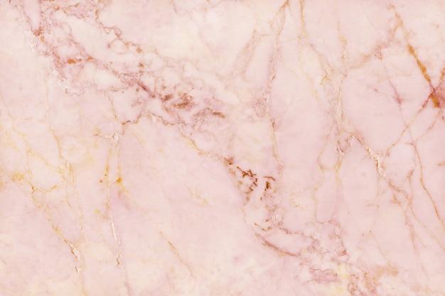 ローズゴールドの大理石のテクスチャ背景、自然なタイルの石造りの床の上から見る