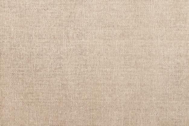 茶色の綿生地のテクスチャ背景、天然繊維のシームレスパターン。