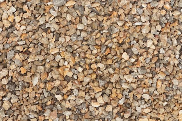 背景のための自然の石のパターン。石の砂利の質感。