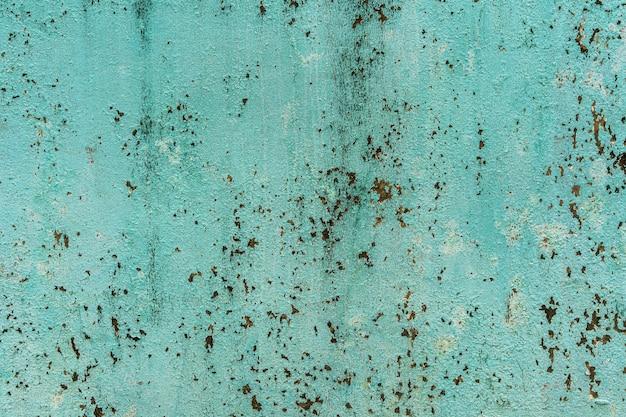 汚れた緑のコンクリート壁の表面