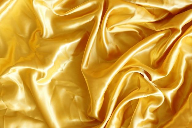 背景の金の生地シルク