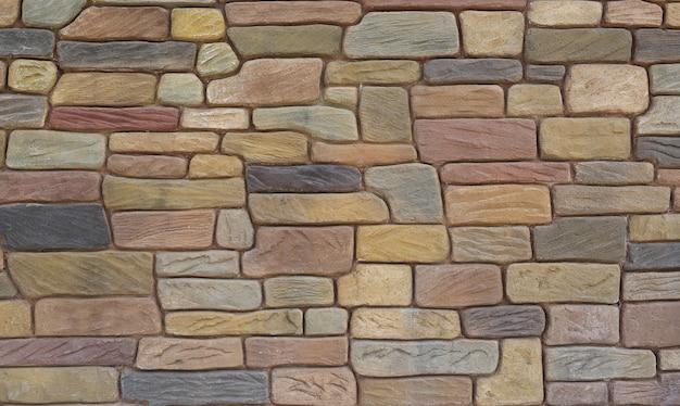 抽象的な石タイルのテクスチャレンガの壁の背景。