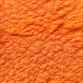 オレンジ色のカーペットの背景テクスチャ