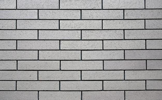 水平グレーのレンガの壁の背景