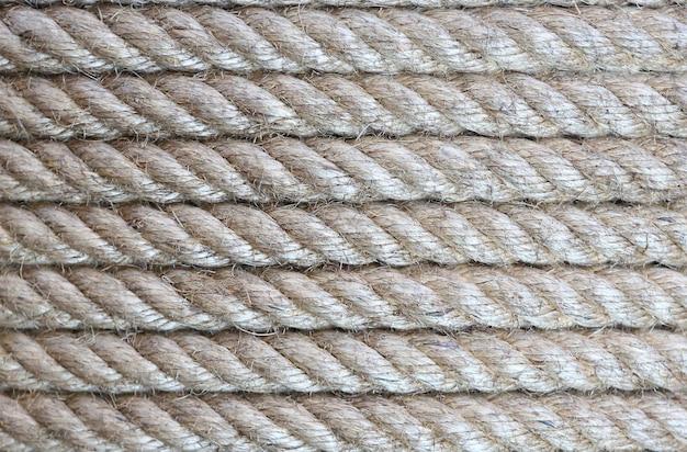 Предпосылка текстуры веревочки (горизонтальные прямые).