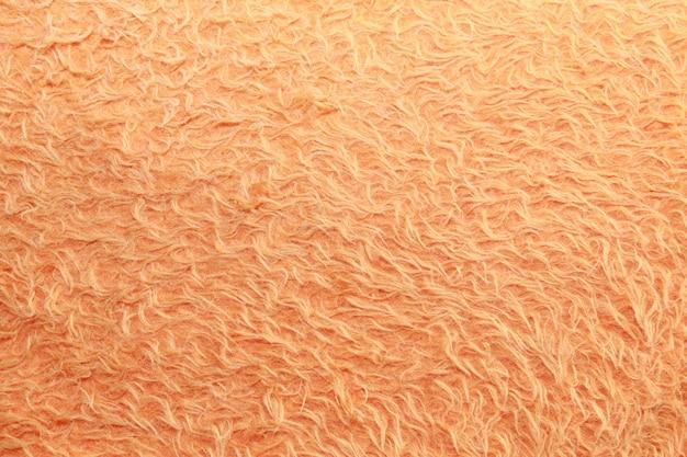 Искусственный мех оранжевый фон.