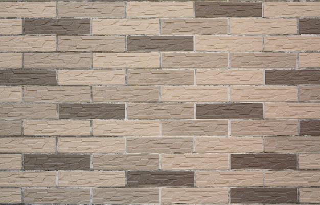 クローズアップモダンなグレーの石のタイルテクスチャレンガの壁