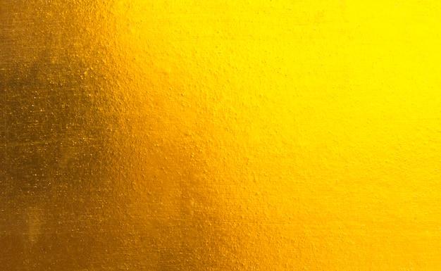 光沢のある黄色の葉金の金属の質感