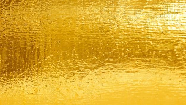 光沢のある黄色の葉の金箔のテクスチャ背景