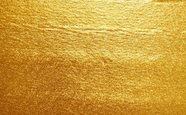 光沢のある黄色い葉の金の質感