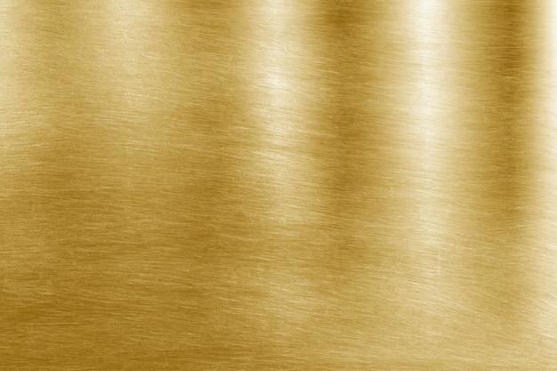 光沢のある黄色い葉の金箔のテクスチャの背景