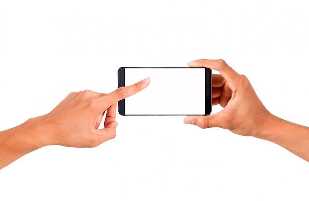 スマートフォンとタッチの手を握っている手