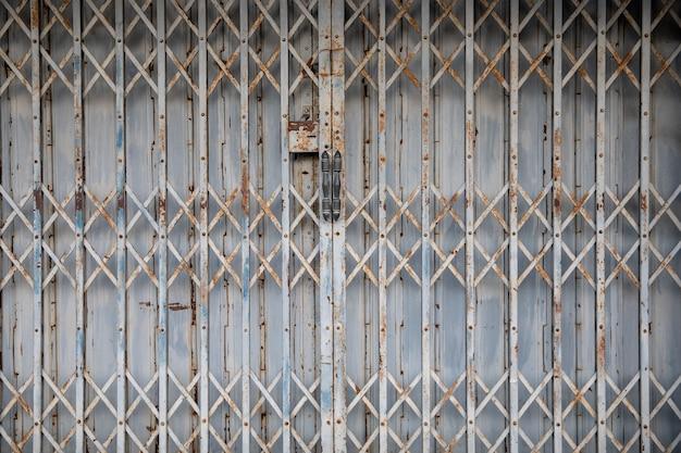 伸ばしたドアテクスチャのパターンの背景