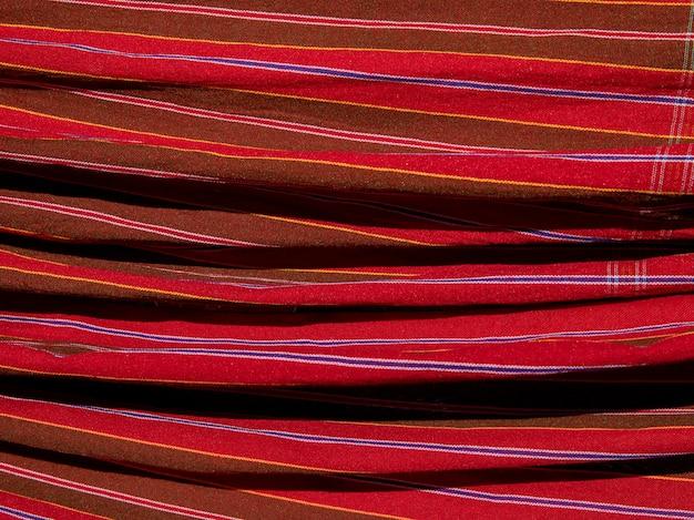 タイのロープライスのローニークロス、美しいタイの生地で飾られたタイスタイルの格子縞の布。
