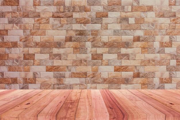 部屋には茶色のレンガの壁と木製の床の背景があります。