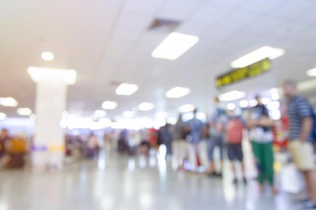 抽象的なぼかし空港ターミナルとラウンジのインテリアの背景