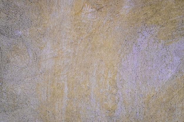 黄色の漆喰壁のテクスチャ背景。