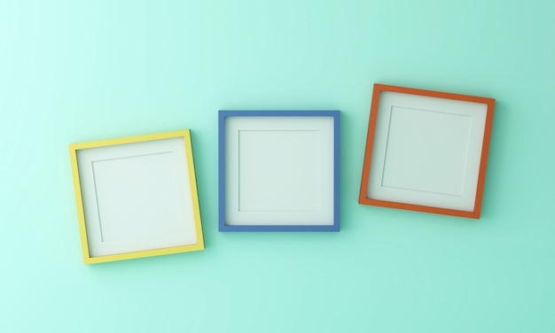 緑色の壁にテキストや画像を挿入するための空白の黄青とオレンジの額縁。