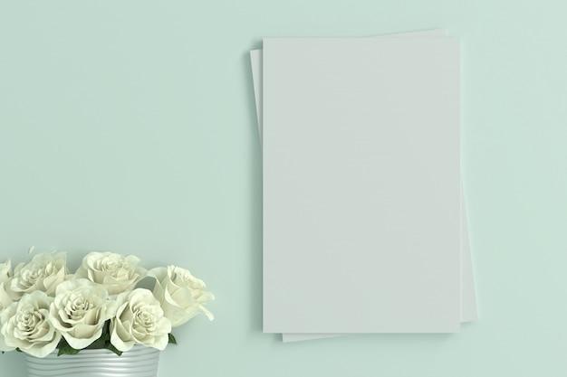 ミントグリーンの部屋で白いバラと空の空白カード