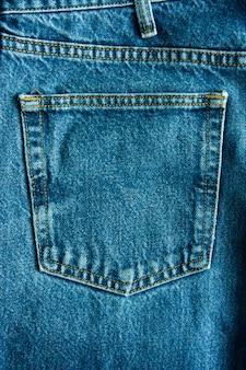 Джинсовый синий джинсовый карман текстуры фона, это классический индиго моды.