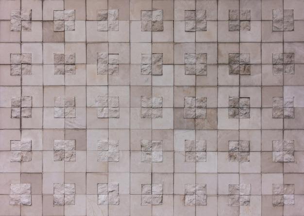 テクスチャ背景の正方形のブロック岩壁