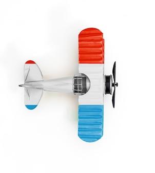 ルクセンブルクの国旗旅行白で隔離される金属のおもちゃの飛行機