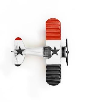 シリアの国旗旅行白で隔離される金属のおもちゃの飛行機