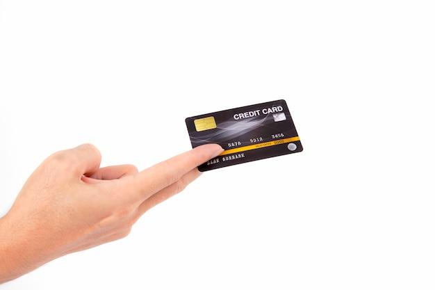 白で隔離されるクレジットカードを持っている手